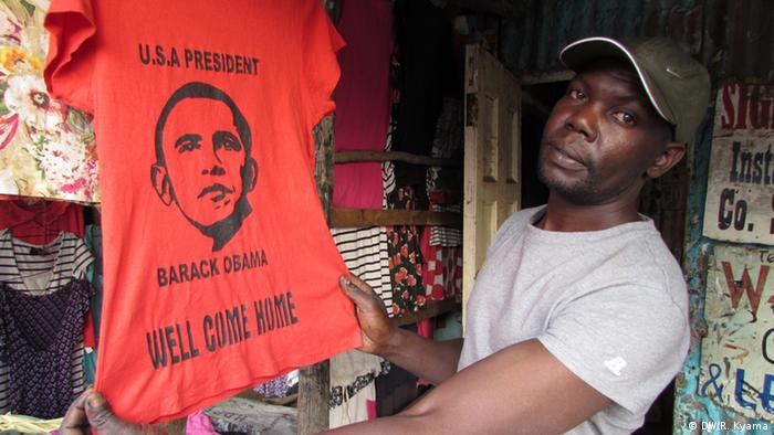 A salesman with a Welcome Obama' T-shirt
