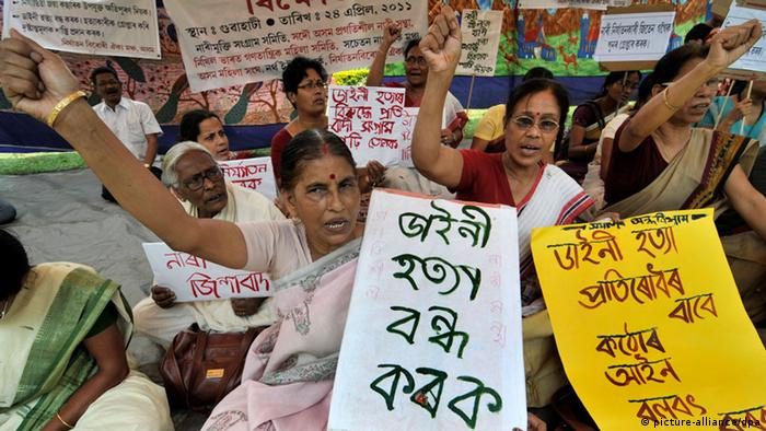 Indian women from various organizations shout slogans as they stage a sit-in demonstration in protest against the recent killings of women in Guwahati city, northeast India, 24 April 2011 (Photo: EPA/STRINGER)
