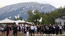 epa04858785 Members of the Special Assistance Team and relatives of victims of the Germanwings Flight 4U 9525 air crash gather to release balloons during a commemorative ceremony at the memorial site in Le Vernet, south-eastern France, 24 July 2015. The Airbus A320 carrying 150 people on board from Barcelona, Spain to Duesseldorf, Germany, crashed 24 March 2015 in the French Alps. About 500 relatives of victims are expected to attend a commemoration ceremony in Le Vernet after burying unidentified remains at the cemetery of the village. EPA/ARNOLD JEROCKI +++(c) dpa - Bildfunk+++