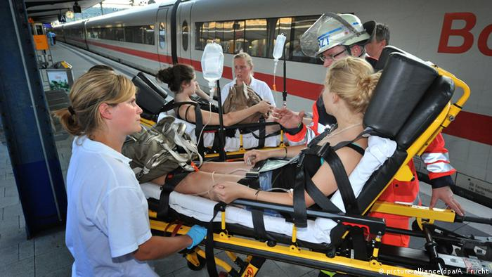 Students get treatment after collapsing on a train