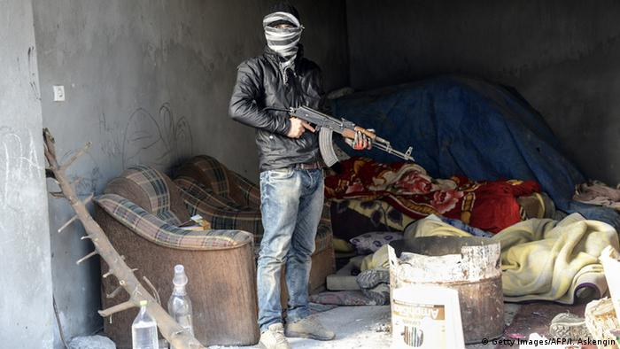 ARCHIVE IMAGE: A member of the Kurdistan Worker's Party (PKK) stands with an AK-47 in the town of Cizre, Sirnak Province in south-eastern Turkey, on December 28, 2014.