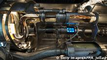 Bildunterschrift:TO GO WITH AFP STORY BY MARIETTE LE ROUX An inside view of the LHC Magnet, which is used to train engineers and technicians, taken on Febuary 10, 2015 at the European Organisation for Nuclear Research (CERN) in Meyrin, near Geneva. Excitement is mounting at the world's largest proton smasher, where scientists are close to launching a superpowered hunt for particles that may change our understanding of the Universe. Physicists and engineers are running the final checks on an upgrade that nearly doubled the muscle of the Large Hadron Collider (LHC), which in 2012 unlocked the putative Higgs boson and, with it, a Nobel Prize. The two-year power boost will take experiments into a previously-inaccessible realm that resembles science fiction. AFP PHOTO / RICHARD JUILLIART (Photo credit should read Richard Juilliart/AFP/Getty Images)