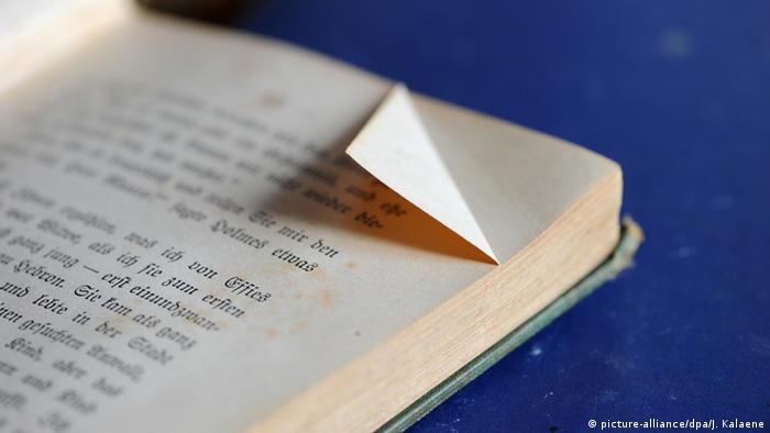 The folded corner of a book's page.