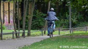A man on a bicycle in Görlitzer Park