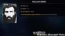 In this image released by the FBI, Mullah Omar is seen in a wanted poster. The reclusive Afghan Taliban leader has backed peace talks with the Kabul government, saying in a rare message distributed to media Wednesday, July 15, 2015 that the goal of these efforts is an end to occupation by foreign forces. (FBI via AP)