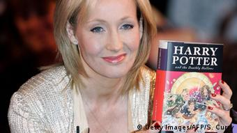J.K. Rowling with Harry Potter book SHAUN CURRY/AFP/Getty Images