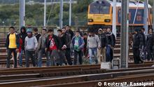 29.07.2015+++ Migrants make their way along train tracks as they attempt to access the Channel Tunnel in Frethun, near Calais, France, July 29, 2015. A migrant died trying to cross to Britain from France early on Wednesday, French police said, adding to a number of recent deaths in the Channel Tunnel as British ministers and security chiefs were to meet over the crisis in Calais. There were about 1,500 attempts by migrants to access the tunnel on Tuesday night, a Eurotunnel spokesman said, after 2,000 attempts the previous night. REUTERS/Pascal Rossignol