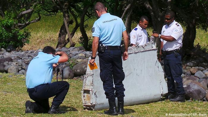 French authorities inspect the discovered debris