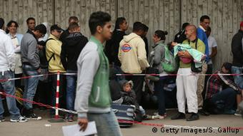 Refugees at Berlin reception center Photo by Sean Gallup/Getty Images