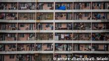 epa04531782 A view of balconies at the Slum Rehaibilitation Authority (SRA) housing building in Mumbai, India, 17 December 2014. Mumbai, being the financial capital of India, attracts a large number of people for employment, but because of less income and expensive housing , people started to live into shanty type structures or in slum colonies. The SRA provides an alternative solution for people living in slums. EPA/DIVYAKANT SOLANKI