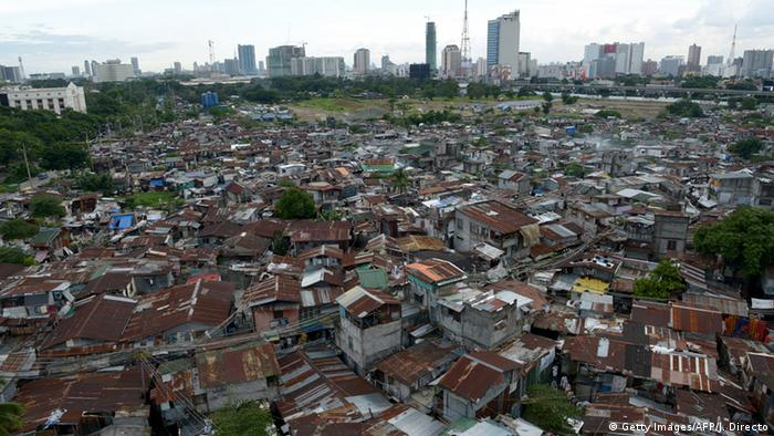 Slum dwellings with highrise skyline in the background