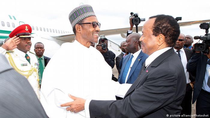 President Buhari and President Biya embrace at the aiport
