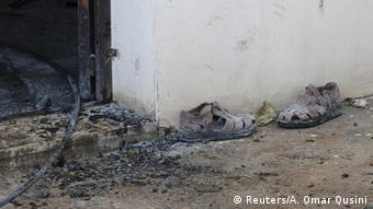 A pair of slippers are seen outside a house that had been torched in a suspected attack by Jewish extremists, killing an 18-month-old Palestinian child, injuring a four-year-old brother and both their parents at Kafr Duma village near the West Bank city of Nablus July 31, 2015.