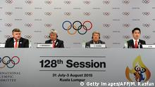 31.07.2015 **** Bildunterschrift:Almaty 2022 Bid Ambassador Denis Ten (R) speaks during a press conference after the bid presentation to host the 2022 Winter Olympics in the Kazakh city of Almaty, at the 128th International Olympic Committee (IOC) session in Kuala Lumpur on July 31, 2015. AFP PHOTO / MOHD RASFAN (Photo credit should read MOHD RASFAN/AFP/Getty Images)