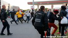 30.07.2015+++ French gendarmes chase migrants near a closed petrol station who gather as they attempt to access the Channel Tunnel in Calais, France, July 30, 2015. Migrants who massed around the entrance to the Channel Tunnel said on Thursday they would keep trying to sneak across to Britain, undaunted by the arrival of 120 extra riot police on the French side. A police officer said the number of migrants trying to enter Britain eased slightly overnight compared to earlier in the week, with about 800 migrants around the site and some 300 intercepted by police. REUTERS/Pascal Rossignol