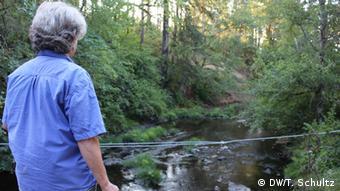 woman next to river copyright: Teri Schultz