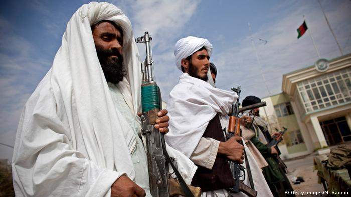 Surrendering Taliban militants stand with their weapons as they are presented to the media on November 4, 2010 in Herat, Afghanistan (Photo: Majid Saeedi/Getty Images)