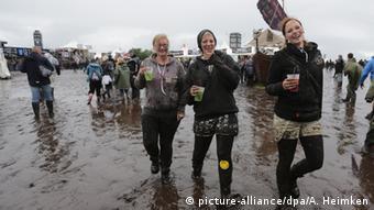 Wacken visitors in the mud, 2015, Copyright: picture-alliance/dpa/A. Heimken
