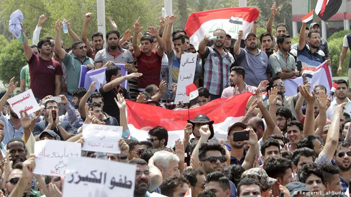 Iraqis shout slogans during a demonstration