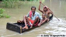 01.08.2015+++ In this photograph taken on August 1, 2015, Indian villagers paddle a small boat through floodwaters in Bherampur Block, Murshidabad District, some 220kms north of Kolkata as the remnants of Cyclone Komen carrying heavy monsoon rains cross the eastern Indian state of West Bengal. Scores have perished in India, Nepal, Pakistan and Vietnam following floods and landslides triggered by heavy seasonal rains. AFP PHOTO/STR (Photo credit should read STRDEL/AFP/Getty Images)
