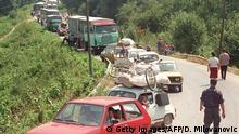 06.08.1995+++ RACA, BOSNIA AND HERZEGOVINA - AUGUST 6: A convoy of Croatian Serb refugees from Knin wait to cross the Bosnian-Rump-Yugoslav border near the eastern Bosnian town of Raca, approximately 130 km (80 miles) west of Belgrade, 06 August. International relief agencies are bracing for a massive exodus of Serb refugees fleeing the Croatian offensive in breakaway Krajina and are beginning to organize food airlifts in order to avoid a humanitarian disaster. AFP PHOTO (Photo credit should read DRAGAN MILOVANOVIC/AFP/Getty Images)
