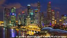 ARCHIV 2012 ***** Skyline of Financial district illuminated at dusk, Singapore, Southeast Asia, Asia