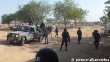 Soldiers of Cameroon's Rapid Intervention Battalion (BIR) patrol the town of Fotokol, Cameroon, near the borders to Nigeria, 10 February 2015 . Photo: Ngala Chimtom/dpa (zu dpa Truppen gegen den Terror: Kameruns Kampf gegen Boko Haram vom 02.03.2015) +++(c) dpa - Bildfunk+++ // eingestellt von se