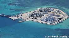 This Philippine military photo claimed to be taken early May and obtained by Jiji Press June 9, 2015, shows aerial view of Johnson South Reef of the Spratly islands in the China South Sea. China has been building facilities on five reefs, and adding construction aggregate to two reefs following land reclamation there.