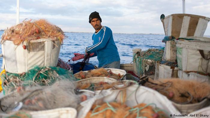 A fisherman on a fishing boat