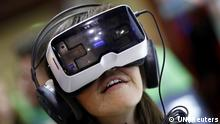 COLOGNE, AUG 5 :- A woman tests a virtual reality headset VR One developed by a German manufacturer Zeiss at the Gamescom 2015 fair in Cologne, Germany August 5, 2015. The Gamescom convention, Europe's largest video games trade fair, runs from August 5 to August 9. REUTERS/UNI PHOTO-13R
