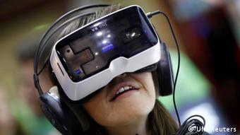 Gamer wearing a virtual reality headset. REUTERS/UNI PHOTO