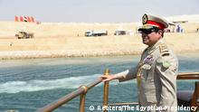 06.08.2015 ***** Egyptian President Abdel Fattah al-Sisi stands in boat on the Suez Canal as he attends the celebration of an extension of the Suez Canal in Ismailia, Egypt, August 6, 2015. Egypt will open an expansion to the Suez Canal to great fanfare on Thursday, the centrepiece of al-Sisi's plans to revitalise the country's economy after years of damaging political turmoil. In this handout courtesy of the Egyptian Presidency. REUTERS/The Egyptian Presidency/Handout via Reuters ATTENTION EDITORS - THIS PICTURE WAS PROVIDED BY A THIRD PARTY. REUTERS IS UNABLE TO INDEPENDENTLY VERIFY THE AUTHENTICITY, CONTENT, LOCATION OR DATE OF THIS IMAGE. NO SALES. NO ARCHIVES. FOR EDITORIAL USE ONLY. NOT FOR SALE FOR MARKETING OR ADVERTISING CAMPAIGNS. THIS PICTURE IS DISTRIBUTED EXACTLY AS RECEIVED BY REUTERS, AS A SERVICE TO CLIENTS.