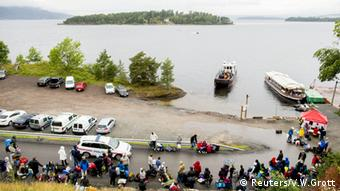 Youths wait for a ferry to take them to Utoya island where Breivik killed people