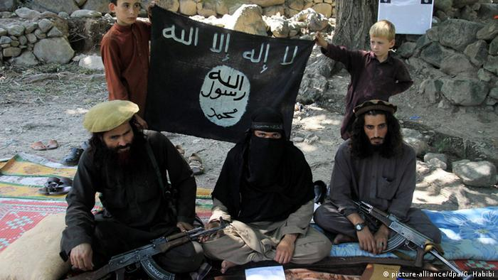 A picture made available on 01 August 2015 shows Gul Dali (R) the district leader of Islamic State (IS) sitting with colleagues and his family at an undisclosed location in Kunar province, Afghanistan, 30 July 2015. More than 1000 Afghan families have been displaced by clashes in the Achin and Spinghar districts in eastern Afghanistan between armed opposition groups, some allegedly claiming allegiance to the group calling themselves the Islamic State (IS) after defecting from the Taliban. EPA/GHULAMULLAH HABIBI