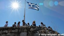 People look out from Acropolis hill in downtown Athens on July 8, 2015. Greece's government on July 8 sharply denied a newspaper report that it was readying IOUs to pay public service pensions and salaries as the country's euro cash dries up. AFP PHOTO / ANDREAS SOLARO (Photo credit should read ANDREAS SOLARO/AFP/Getty Images)