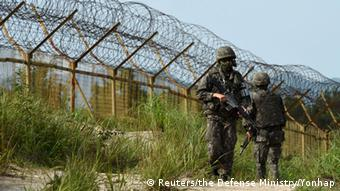 South Korean soldiers patrol along the scene of a blast inside the demilitarized zone separating the two Koreas in Paju, South Korea, in this picture taken on August 9, 2015.