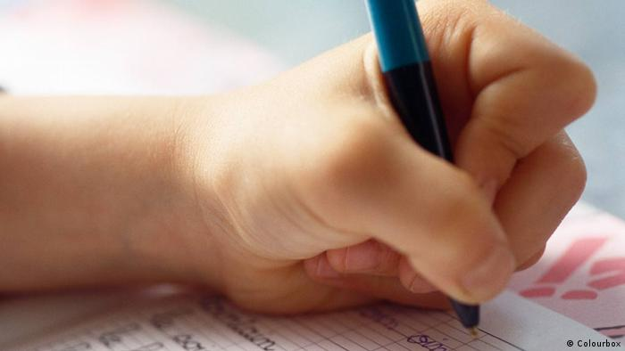 Close-up of child's hand writing (Photo: Colourbox)
