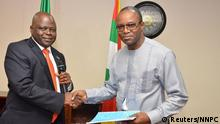August 5, 2015 Dr. Emmanuel Ibe Kachikwu (R), the new managing director of the Nigerian National Petroleum Corp (NNPC), shakes hands with the former Group Managing Director of NNPC, Dr. Joseph Thlama Dawha during a handover ceremony in Abuja, Nigeria, in this August 5, 2015 handout photograph made available to Reuters August 6, 2015. Kachikwu, the new head of Nigeria's state oil company is a workaholic stickler for the rules with a strong background in law, qualities he will need if he is to overhaul an organisation notorious for corruption and mismanagement. REUTERS/NNPC/Handout via ReutersATTENTION EDITORS - THIS PICTURE WAS PROVIDED BY A THIRD PARTY. REUTERS IS UNABLE TO INDEPENDENTLY VERIFY THE AUTHENTICITY, CONTENT, LOCATION OR DATE OF THIS IMAGE. FOR EDITORIAL USE ONLY. NOT FOR SALE FOR MARKETING OR ADVERTISING CAMPAIGNS. THIS PICTURE IS DISTRIBUTED EXACTLY AS RECEIVED BY REUTERS, AS A SERVICE TO CLIENTS. NO SALES. NO ARCHIVES.