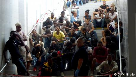 Refugees sat on the platform staircase in Rosenheim train station