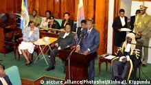 (150811) -- KAMPALA, Aug. 11, 2015 () -- Kenyan President Uhuru Kenyatta (standing) delivers a speech at Uganda's parliament in Kampala, Uganda, Aug. 10, 2015. Uhuru Kenyatta addressed Uganda's parliament and in his speech he urged the East African region to harness its shared identities as the strongest asset to develop its economy. (Xinhua/Joseph Kiggundu) (zjy)