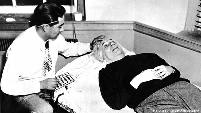 A scientist in 1950 attempts to read and record Albert Einstein's brain activity with electrodes attached to the astrophysicist's head