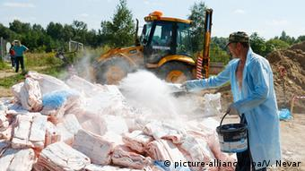 Russian officials destroy cured pork fat illegally imported from the EU