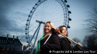 Two London tour guides in front of the London Eye, the big wheel on the banks of the Thames.