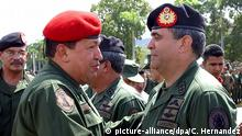 A picture dated 13 April 2005 shows President Hugo Chavez (L) handshaking ex- minister of Defense General Raul Isaias Baduel (R) in Caracas, Venezuela. Chavez denied on 8 May 2010 that he was involved in the trial decision of the former defense minister and former ally, general Raul Isaias Baduel and considered that it was justified. CARLOS HERNANDEZ/dpa