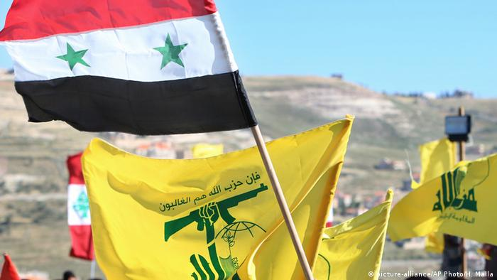 Syrian and Hezbollah flags