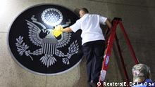 14.08.2015 **** A worker cleans the seal of the United States of America after it was placed on the wall at the main entrance of the U.S. embassy in Havana, Cuba, August 14, 2015. U.S. Secretary of State John Kerry travels to Cuba on Friday to raise the U.S. flag at the recently restored American embassy in Havana, another symbolic step in the thawing of relations between the two Cold War-era foes. REUTERS/Enrique De La Osa