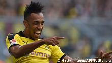 15.8.2015 *** Bildunterschrift:Dortmund's Gabonese striker Pierre-Emerick Aubameyang celebrates scoring during the German first division Bundesliga football match Borussia Dortmund vs Borussia Moenchengladbach in Dortmund, western Germany, on August 15, 2015. AFP PHOTO / PATRIK STOLLARZ RESTRICTIONS: DURING MATCH TIME: DFL RULES TO LIMIT THE ONLINE USAGE TO 15 PICTURES PER MATCH AND FORBID IMAGE SEQUENCES TO SIMULATE VIDEO. == RESTRICTED TO EDITORIAL USE == FOR FURTHER QUERIES PLEASE CONTACT DFL DIRECTLY AT + 49 69 650050. (Photo credit should read PATRIK STOLLARZ/AFP/Getty Images)