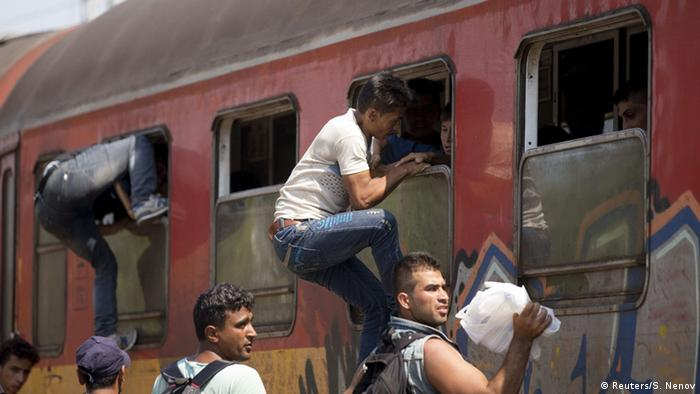 Refugees trying to get on a train at Gevgelija train station in Macedonia REUTERS/Stoyan Nenov