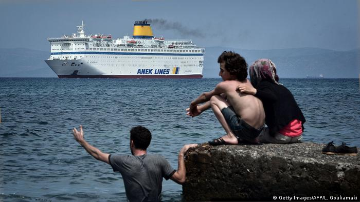Refugees watching a ferry, Kos. (Louisa Gouliamaki/AFP)