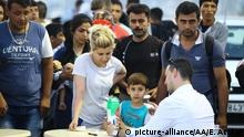 August 15, 2015 KOS, GREECE - AUGUST 15 : Around 1900 Syrian refugees wait outside Anek Lines' passenger ship 'Eleftherios Venizelos' in Greek Island of Kos on August 15, 2015. The cruise ship will be used as a registration centre and later on will take refugees to Greece on August 15, 2015. Evren Atalay / Anadolu Agency